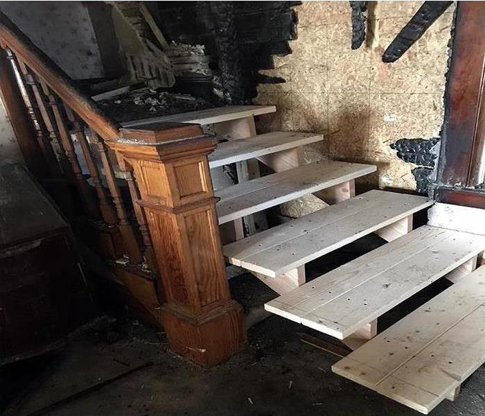 news stairs in a home that replaced the burnt ones after a fire