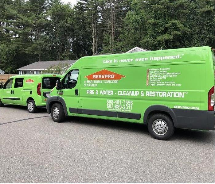 SERVPRO vehicles in front of house