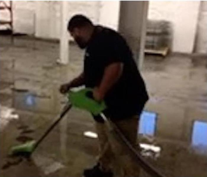 A male SERVPRO employee using SERVPRO equipment.