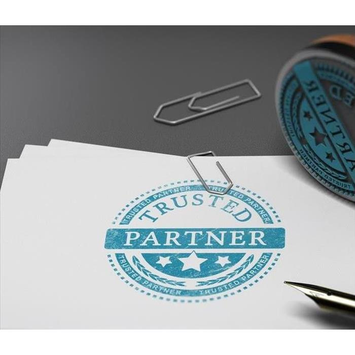 "A document that reads "" Trusted Partner"""