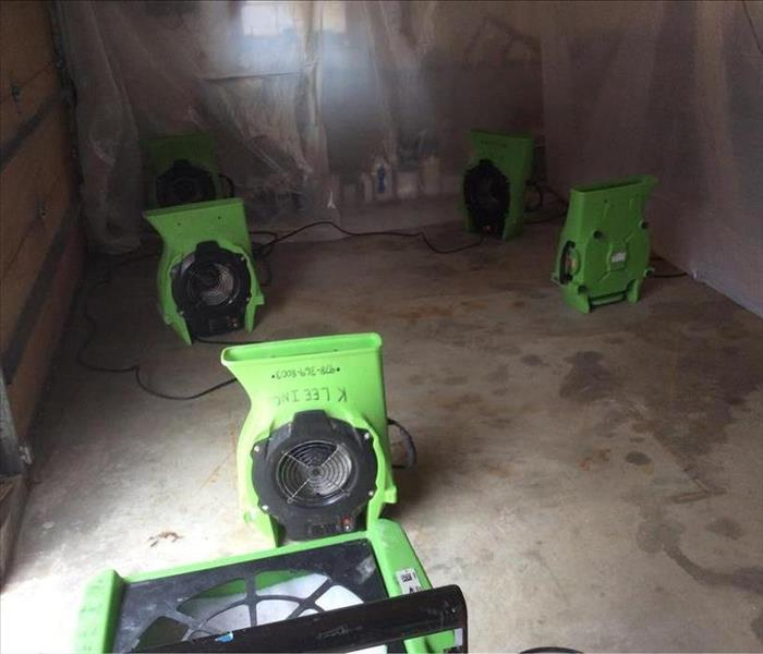 containment barrier of poly sheeting in a garage with air movers